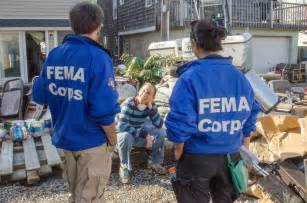 Fema corps talking with disaster survivor
