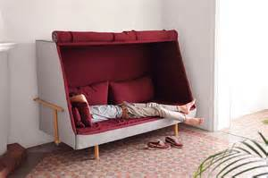 a sofa that can turns into a bed and a cabin fubiz media