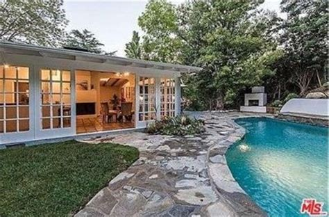 Posey House by Posey Picks Up A Cabana Style Home With Lagoon Pool