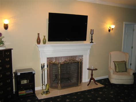 mounted tv fireplace clinton ct tv install above fireplace in wall wire concealment richey llc audio