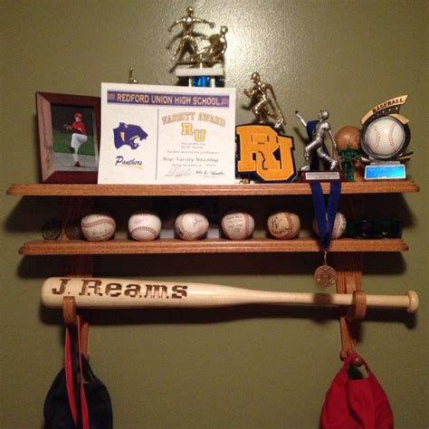 my made this shelf to hold my sons baseball trophies