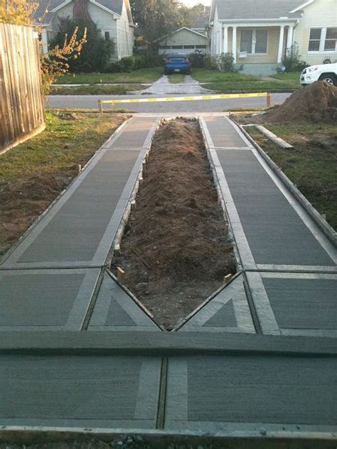ribbon driveway the concrete strips in a ribbon driveway should be at least 2 feet in width and