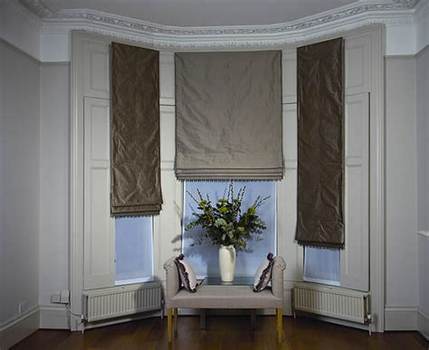 How To Dress Windows | dressing bay windows with curtains and blinds