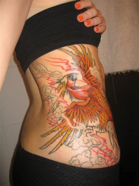 phoenix tattoo with background 50 incredibly attractive phoenix tattoos for prosperity
