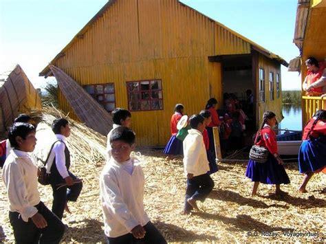 aymara indian youth returning  school lake titicaca peru