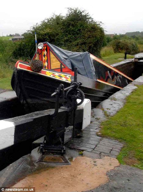 canal boat crash pictured terrifying moment a narrowboat became wedged in