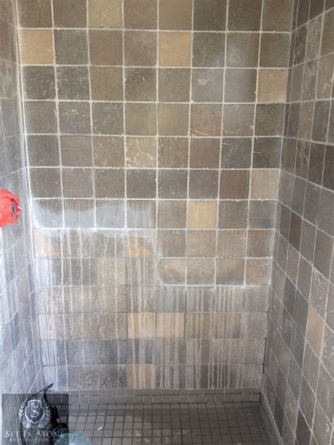 Shower wall has been 50% restored. Years of soap scum and
