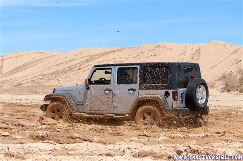 jeep stuck in mud cowgirl skylar stuck in mud with her jeep