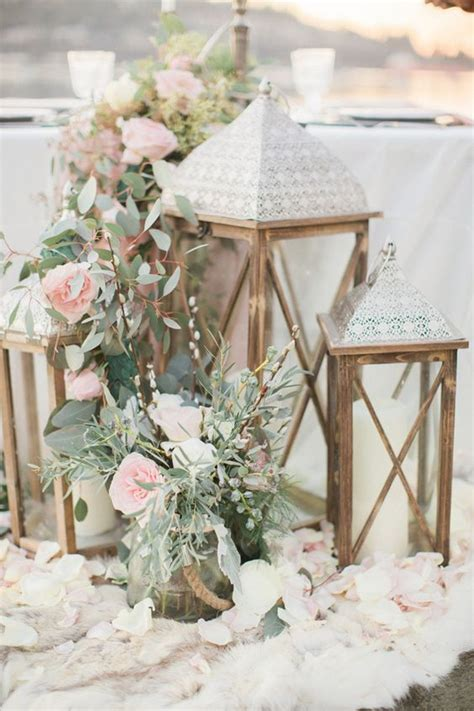 lanterns with flowers centerpieces 25 best ideas about rustic lantern centerpieces on
