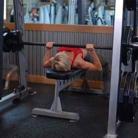 using smith machine for bench press smith machine bench press exercise guide and video