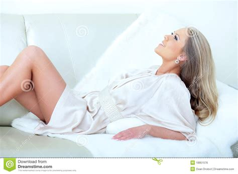 lying down in bed woman lying down on her bed royalty free stock image