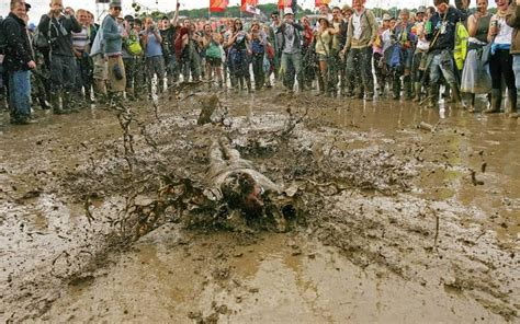 the at glastonbury the worst mud at glastonbury in pictures