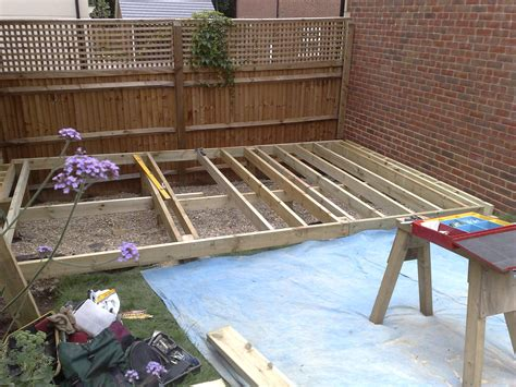 how to level a backyard slope working in progress the foundations for garden decking