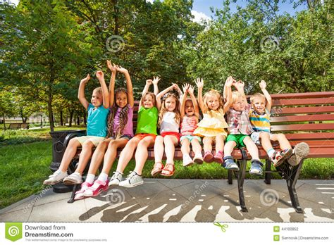 bench girls happy children in park bench stock photo image 44100852
