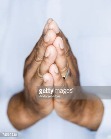 african american mans hands in prayer position stock photo