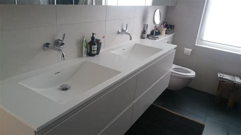 Corian Bathroom Shelves and Custom Made Corian Basins in London
