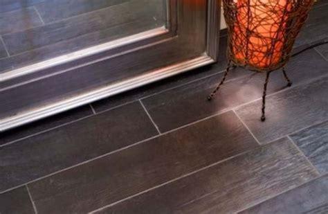 Porcelain wood look tiles or laminate wood floors?