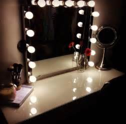 Makeup And Vanity Set A Glowing Light Lighted Mirror Vanity Table Casa