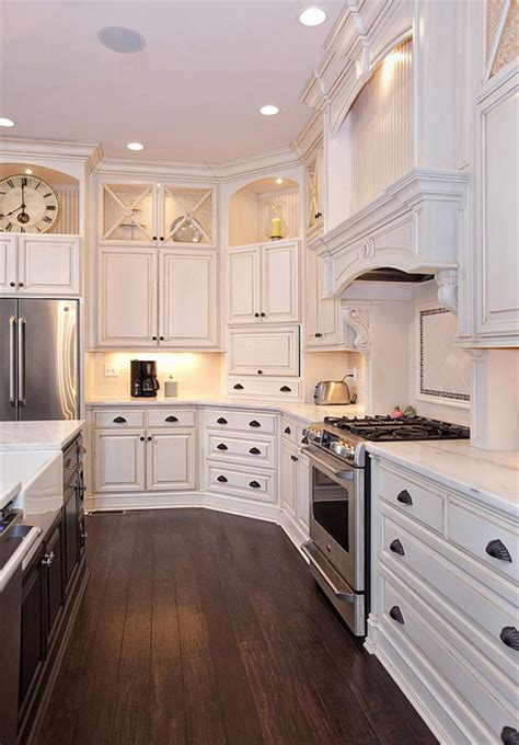 white kitchen cabinets dark wood floors love the white cabinets with alcoves great contrast with