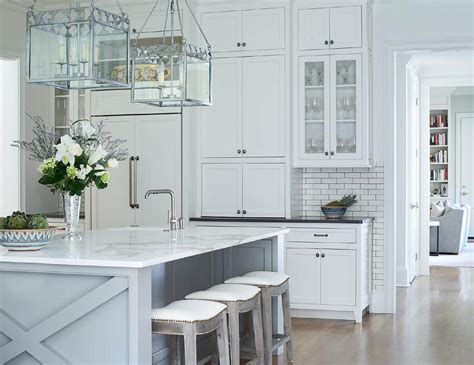 white shaker kitchen cabinets with grey island mixed metal kitchen knobs design ideas