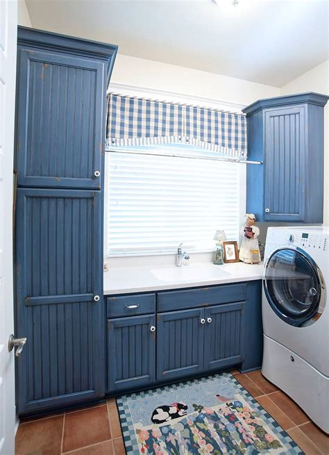 blue cabinets giggles and laundry country style blue laundry room laundry room pinterest