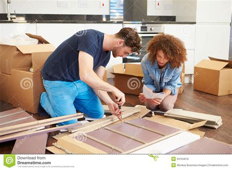 putting together self assembly furniture in new