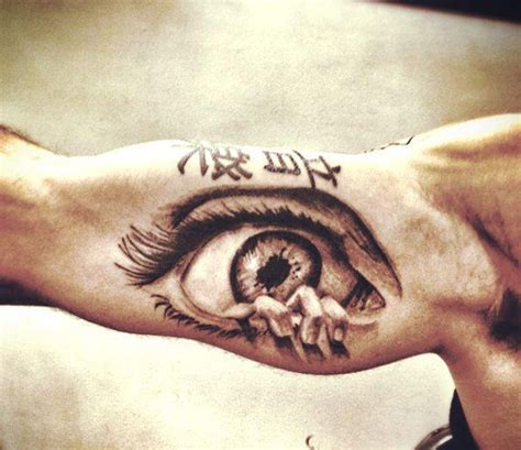 creepy eye tatoos 2016