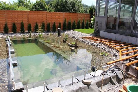 backyard swimming pond this s ambitious project for his backyard actually