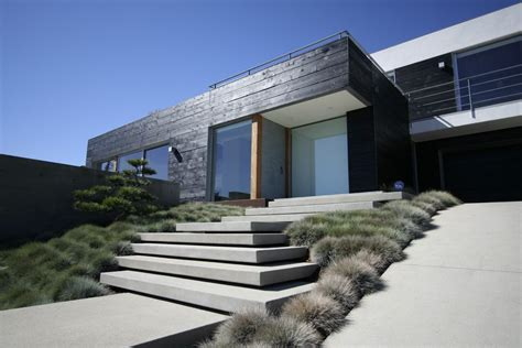 front stairs exterior modern with balcony black garden fencing