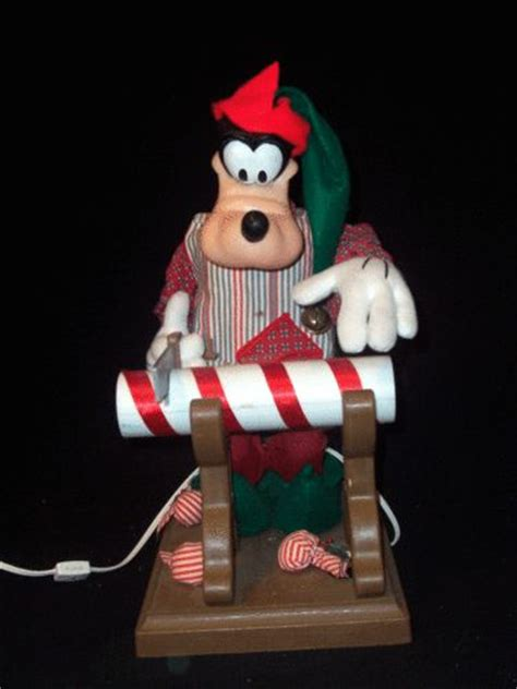 santas best animated goofy sawing candy cane disney figure