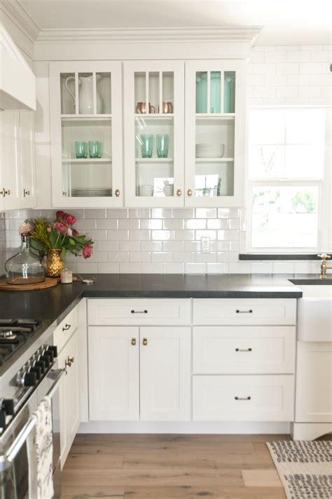 white shaker cabinetry with glass cabinets as