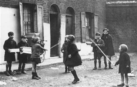 children playing with a skipping rope in the street, 19