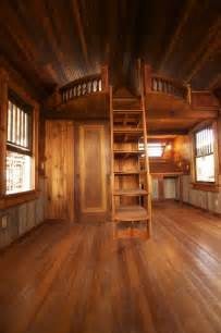 tiny house with loft extended round loft wood all round entry to the left of picture frame bathroom with tub