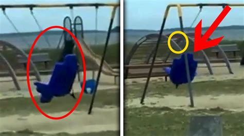 moms swing dad films ghost playing on playground swing in rhode