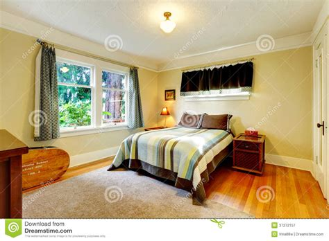 yellow and beige bedroom refreshing furnished bedroom royalty free stock