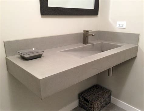 Dark Bathroom corner gray composite concrete floating trough sink