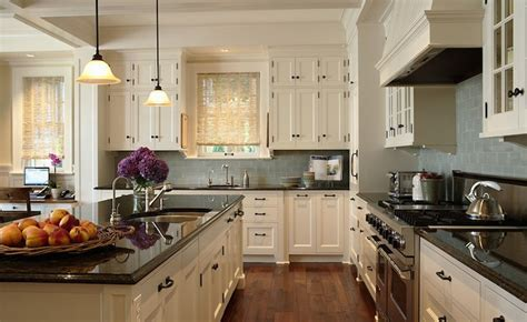 Ivory KItchen Cabinets with Black Countertops