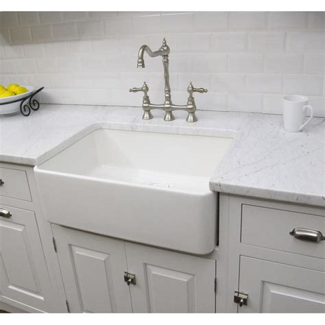 Constructed of fireclay this large bathroom sink has a classic design and is already assembled