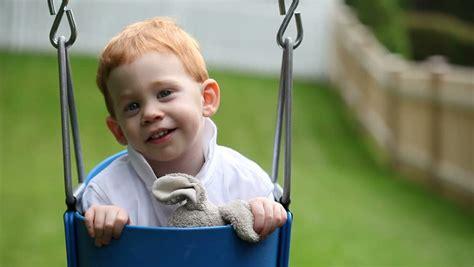 cute baby swings cute baby boy sitting in swing stock footage video 463579