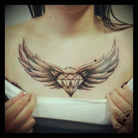 great diamond with wings tattoo designs on chest