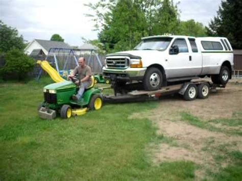 tow boat with lawn tractor john deere lawn tractor pulls f350 dually youtube
