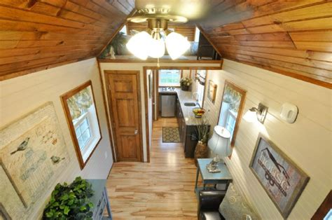 112 square feet off grid tiny house with folding porch roof off grid 272 square foot tiny house on wheels for 65 000