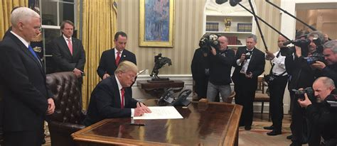 trumps oval office on first day trump signs health care executive order