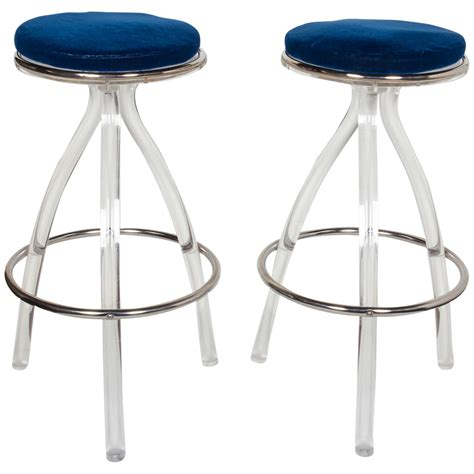 pair of ultra modernist lucite bar or counter stools at