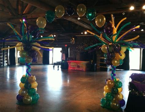 mardi gras balloon decor, columns, arches and centerpieces