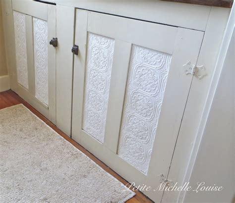 Wallpaper On Cabinet Doors by Louise Diy Cabinet Door Facelift