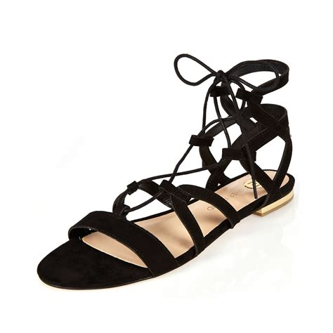 black flat strappy shoes river island black strappy gladiator sandals in black lyst