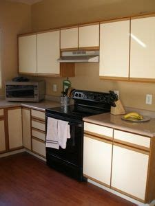 refinish laminate kitchen cabinets 1000 ideas about laminate cabinets on pinterest