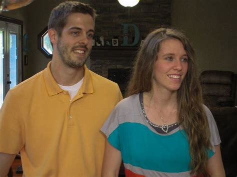 jill and derrick dillard march 27 2015 duggars laugh as one of them tries to sled over a cat