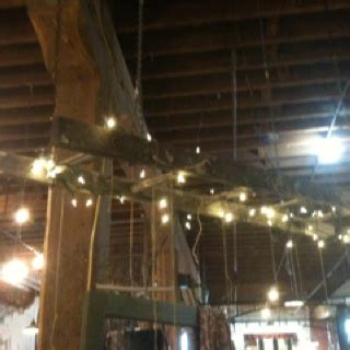 Hanging String Lights From Ceiling String Ladder With Lights Hang From Ceiling With Chain Chandelier Saw This At Juju